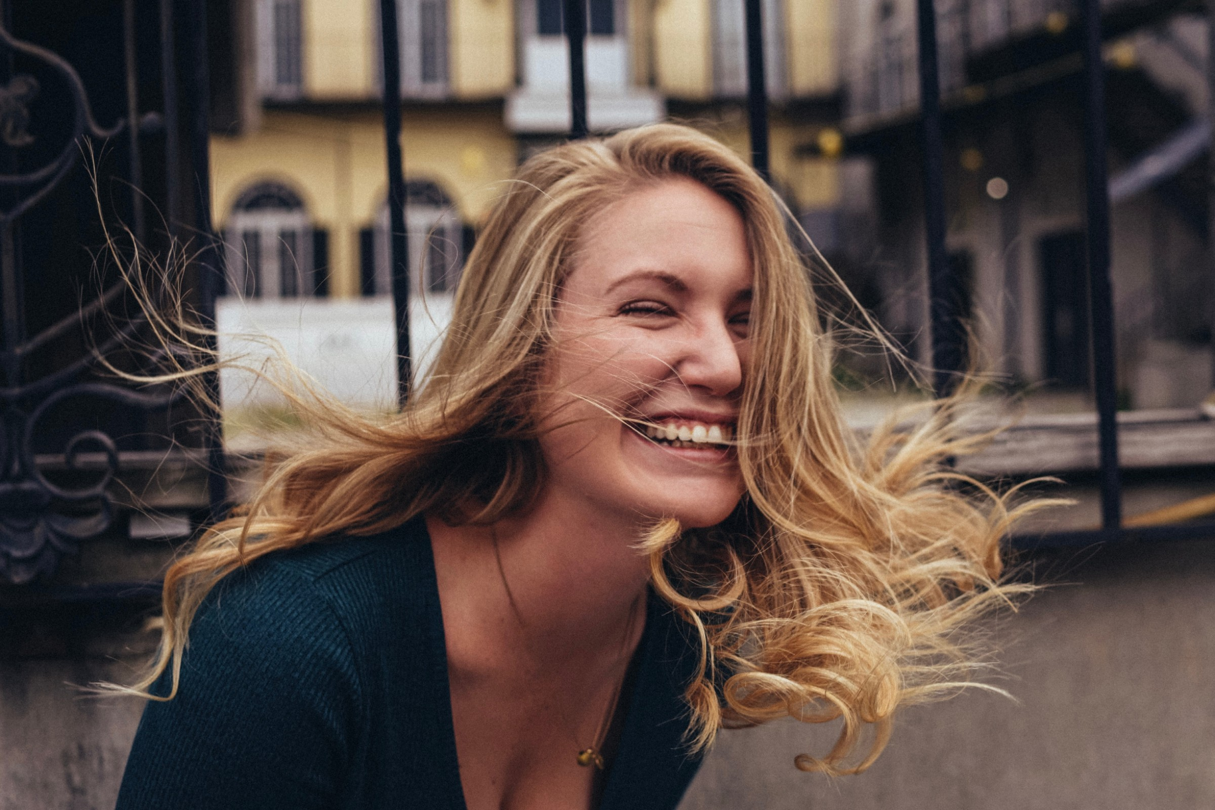 Laughing blonde woman after labiaplasty