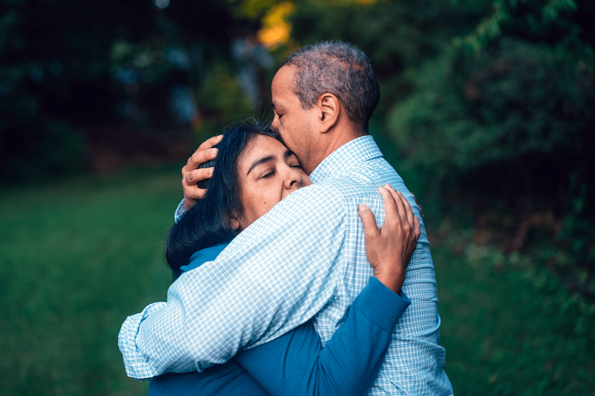 Hispanic woman menopause hugging husband