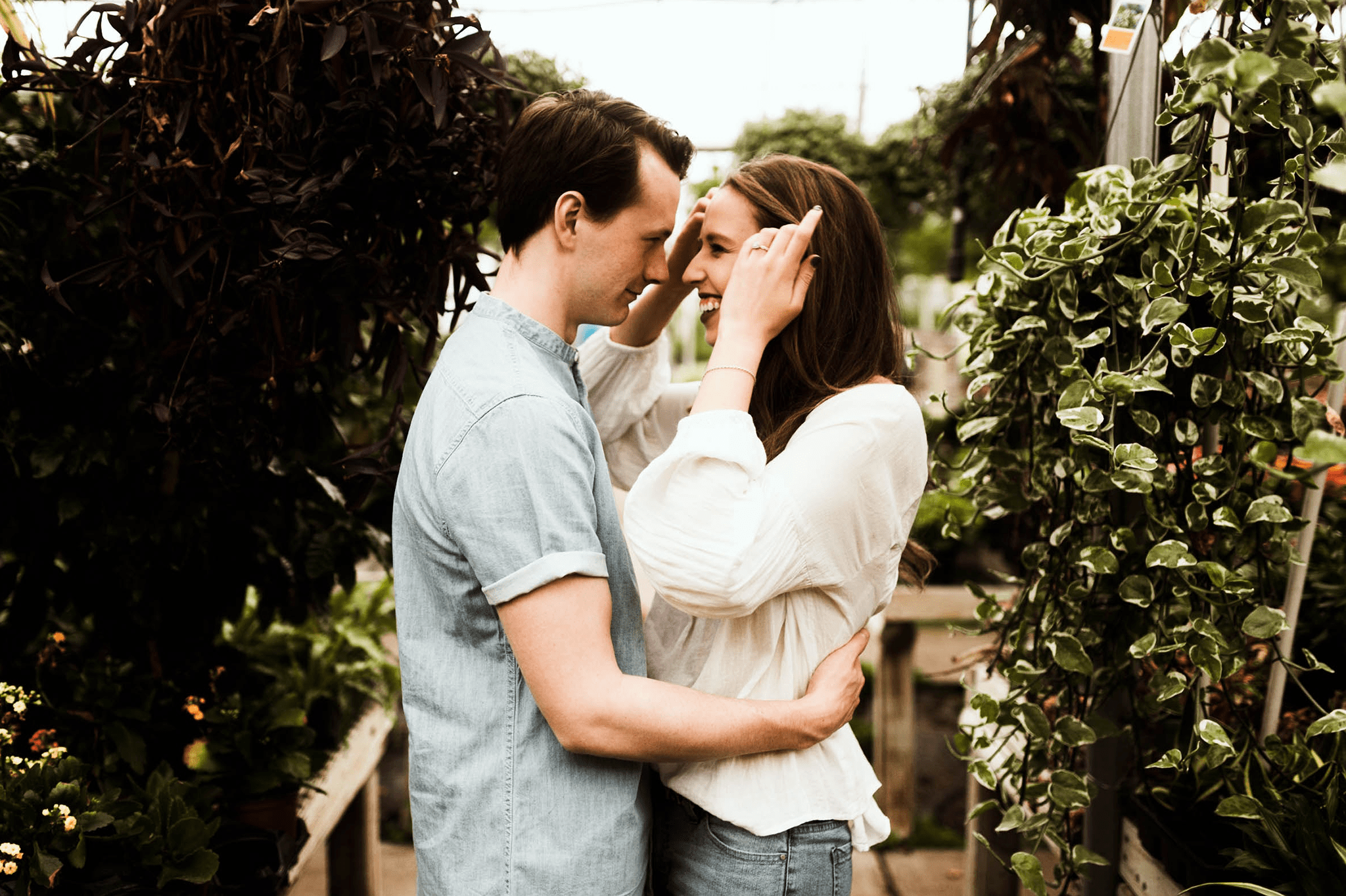 smiling young couple in garden - patient forms vaginal rejuvenation - female cosmetic surgery