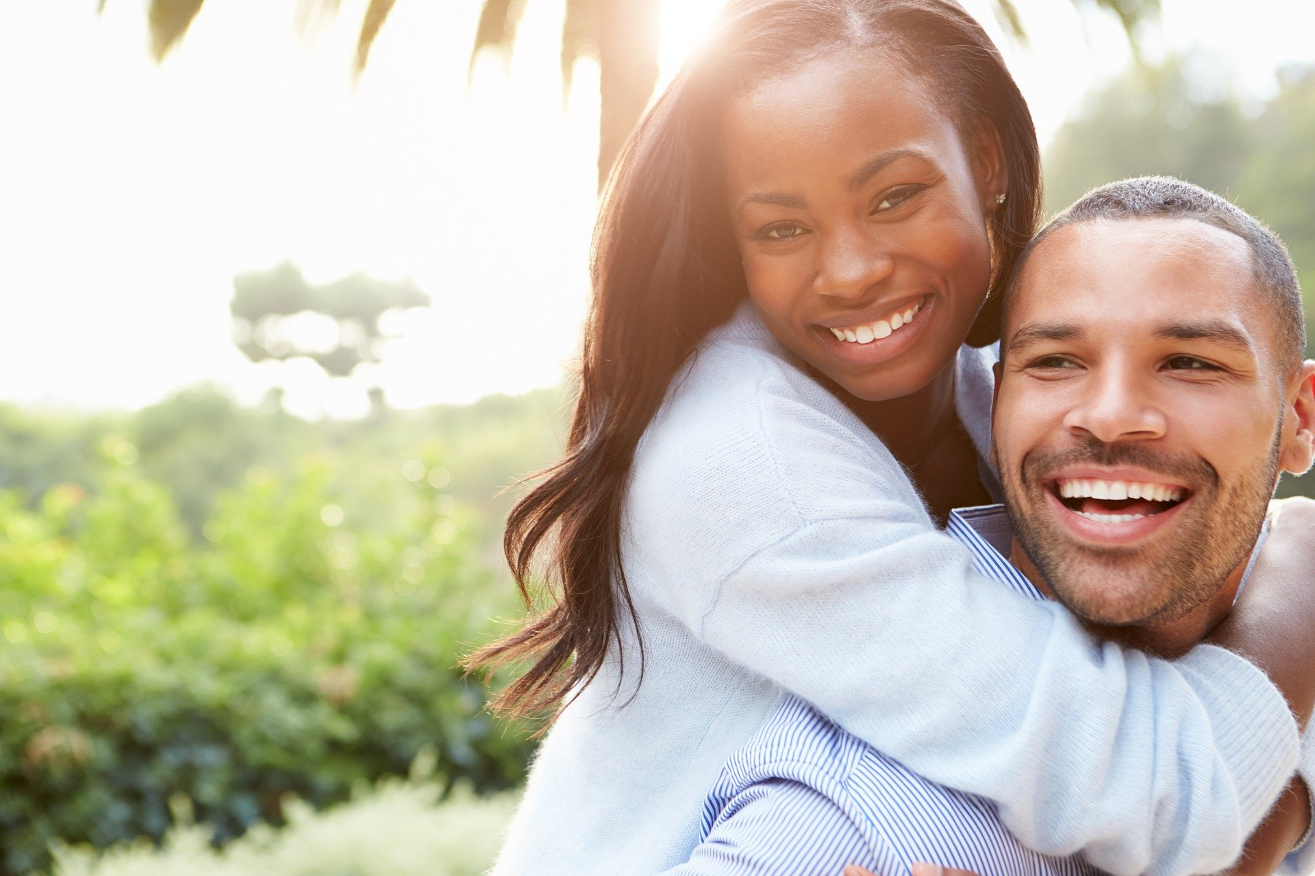 Happy Black woman with partner | Queefing informational blog post